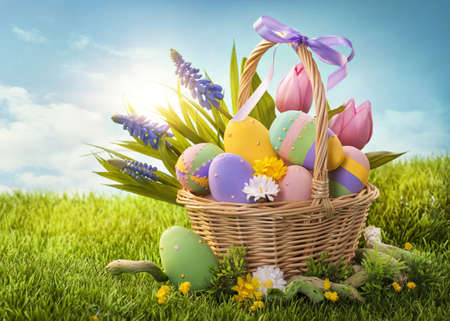 Photo for Basket with easter eggs  on green grass - Royalty Free Image