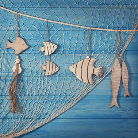 Foto de Marine life decoration and on blue shabby background - Imagen libre de derechos