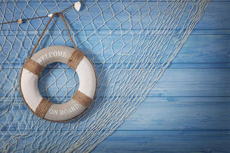 Foto de Life buoy decoration on blue shabby background - Imagen libre de derechos