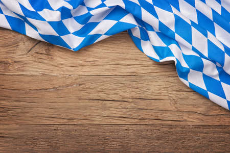 Foto de Oktoberfest blue checkered fabric on wooden background - Imagen libre de derechos
