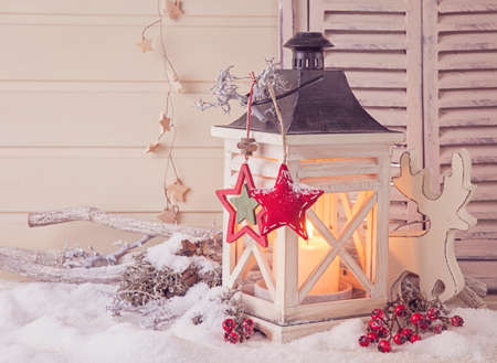 Photo for Burning lantern and christmas decoration on white background - Royalty Free Image