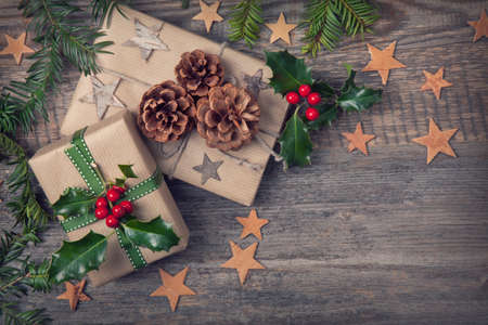 Photo pour Christmas vintage presents on a wooden background - image libre de droit