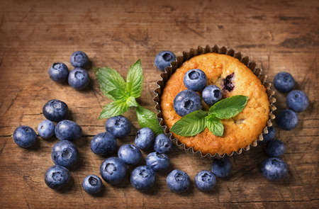 Photo for Blueberry muffins in old metal cupcake holder - Royalty Free Image