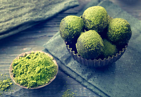 Photo for Matcha energy balls dusted with bright green matcha powder - Royalty Free Image