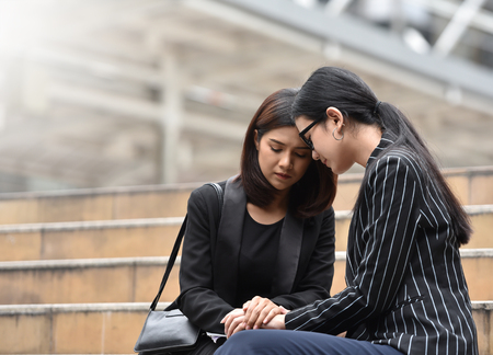 Foto de Sadness Young Asian Business women crying and sitting on the stair. Sacked. - Imagen libre de derechos