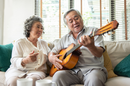 Photo pour Happy Retirement Older Couple enjoying with singing and guitar together. Having fun. - image libre de droit