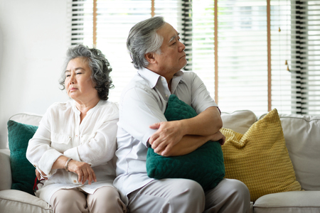 Foto de Sad Senior couple having a conflict and relationship problems. Sulking. - Imagen libre de derechos