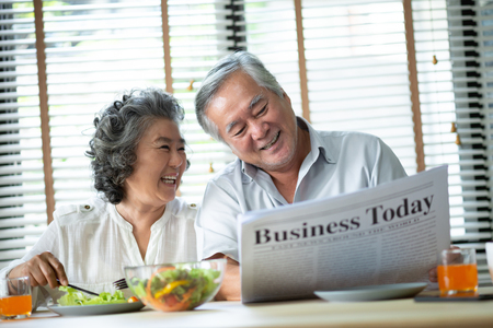 Foto per Relaxing Asian Senior couple talking together with breakfast on the morning at the house. Retirement. - Immagine Royalty Free