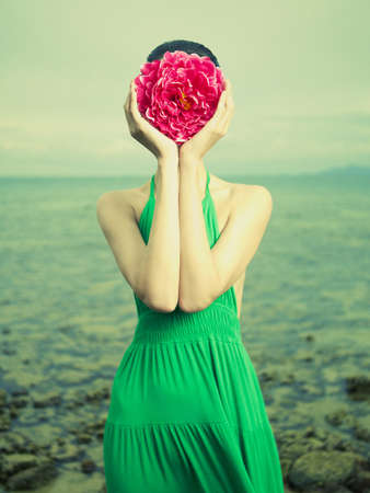 Photo for Surreal portrait of a woman with a flower instead of a face - Royalty Free Image