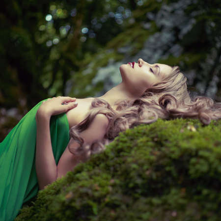 Photo for Portrait of elegant woman with luxurious hair in a coniferous forest - Royalty Free Image