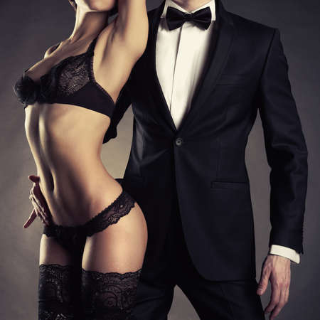 Photo pour Art photo of a young couple in sensual lingerie and a tuxedo - image libre de droit