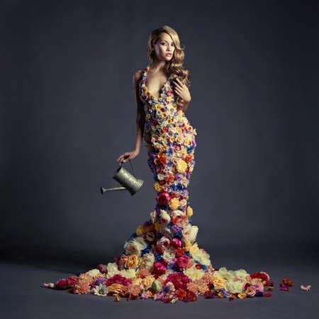 Foto de Studio portrait of blooming gorgeous lady in dress of flowers - Imagen libre de derechos