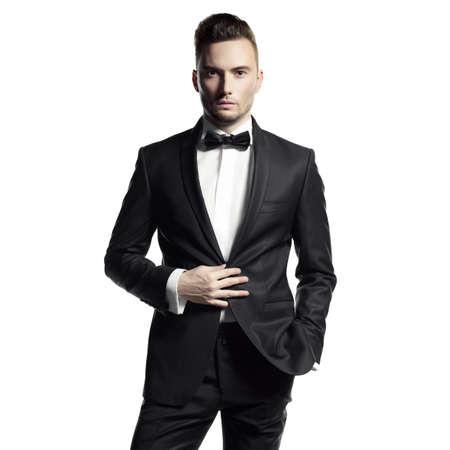 Photo pour Portrait of handsome stylish man in elegant black suit - image libre de droit