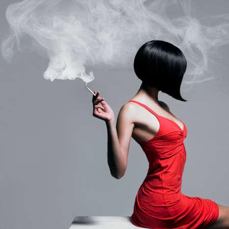 Foto de Fine art portrait of a beautiful lady with cigarette - Imagen libre de derechos