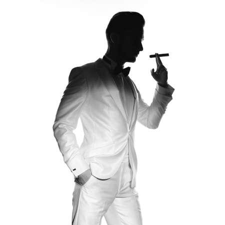 Photo pour Concept photo of handsome stylish man with cigar - image libre de droit
