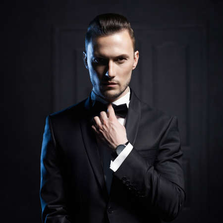 Photo for Portrait of handsome stylish man in elegant black suit - Royalty Free Image