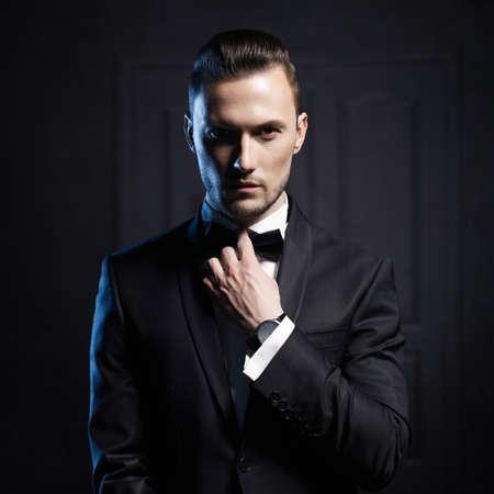 Foto de Portrait of handsome stylish man in elegant black suit - Imagen libre de derechos