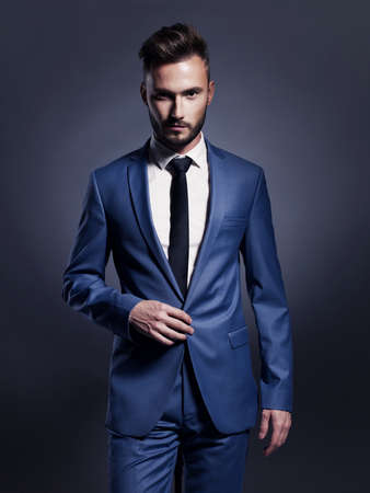 Photo for Portrait of handsome stylish man in elegant blue suit - Royalty Free Image