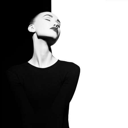 Foto de Fashion art studio portrait of elegant blode in geometric black and white background - Imagen libre de derechos