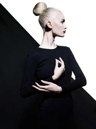 Foto de Fashion art studio portrait of elegant blode in geometric black and white background - Imagen libre de derechos