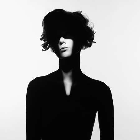 Photo pour Black and white art fashion surrealistic portrait of beautiful woman with a beam of light on her face - image libre de droit