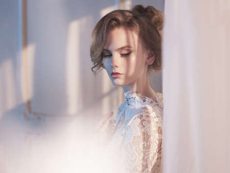 Photo pour Art fashion photo of beautiful gorgeous woman in lace dress at the window. Beauty and health. Wedding style. Bridal morning - image libre de droit
