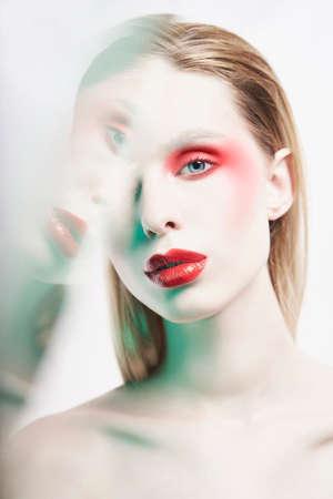 Foto de Studio portrait of sexy lady with blonde hair. Woman posing with colorful lipstick. Beautiful girl with bright makeup. Portrait with mirrrors. - Imagen libre de derechos