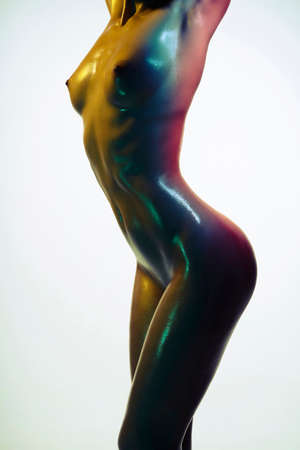 Foto de Fashion photo of sexy woman. Beautiful nude lady. Model posing in the colored lights. - Imagen libre de derechos