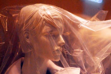 Foto de shop window dummy covered in plastic, symbol for isolation, human psyche - Imagen libre de derechos
