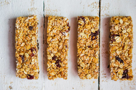 Photo for Granola bar on wooden background - Royalty Free Image