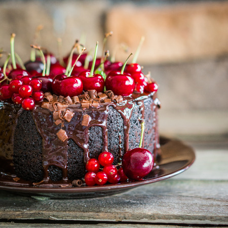 Photo for Chocolate cake with cherries on wooden background - Royalty Free Image