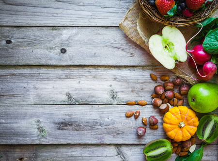 Foto de Fruits and vegetables on rustic background - Imagen libre de derechos