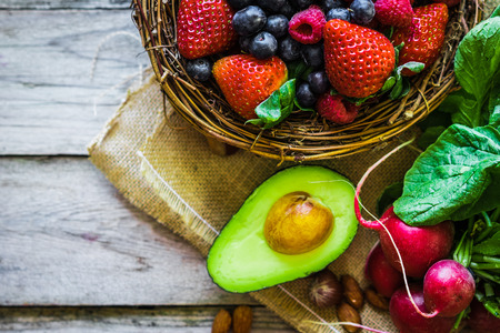 Photo pour Fruits and vegetables on rustic background - image libre de droit