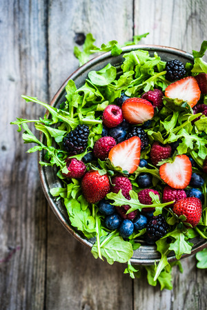 Photo for Green salad with arugula and berries - Royalty Free Image