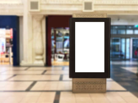Foto de Empty indoor portrait digital signage light box with blurred mall background. Ideal for digital advertisement, information board, mall ads, video wall and large posters for campaigns - Imagen libre de derechos