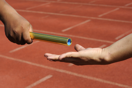 Foto per Relay-athletes hands sending action  - Immagine Royalty Free