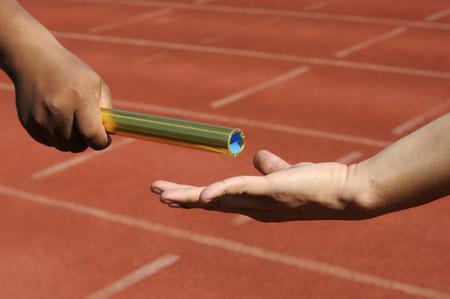Photo pour Relay-athletes hands sending action  - image libre de droit