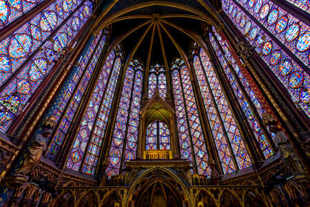 Photo for PARIS, FRANCE - MAY 22: Stained Glass Interior in The Sainte-Chapelle in Paris, France. The Sainte-Chapelle is a royal chapel in the Gothic style, within the medieval Palais de la Cite - Royalty Free Image