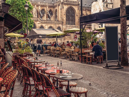 Photo for Cozy street with tables of cafe in Paris, France - Royalty Free Image