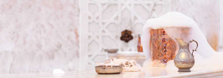 Photo for Water jar, towel and copper bowl with soap foam in turkish hamam. Traditional interior details. Horizontal, wide screen format, banner format - Royalty Free Image