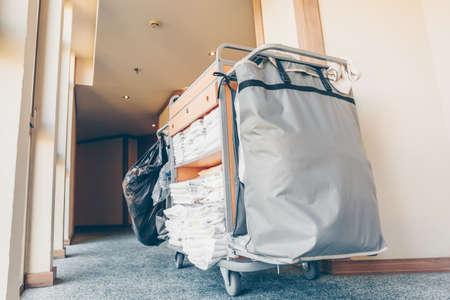Photo pour Housekeeping cart in the hotel corridor. Horizontal, light blue toning - image libre de droit