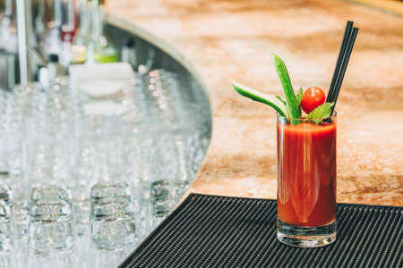 Photo pour Bloody Mary cocktail at the bar stand. Luxury vacation concept. Horizontal - image libre de droit