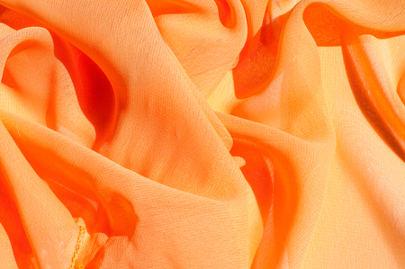 Photo for Background texture pattern. Silk crepe of chiffon peach peachpuff Introducing the sultry and stunning  Silk Satin you see here. Duchess satin is a gorgeous high-fiber count medium-bodied low luster - Royalty Free Image