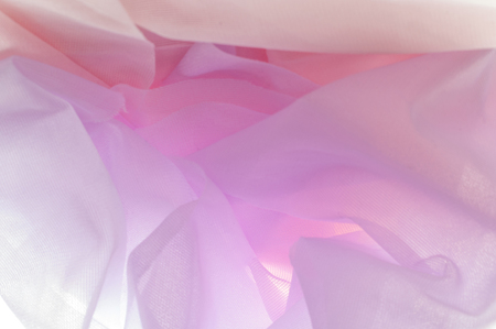 Photo for background texture Beautiful lightweight airy fabric this phenomenal nylon tulle! For those who are not familiar with tulle fabric in general, this is a thin, often starched mesh fabric used for packs - Royalty Free Image