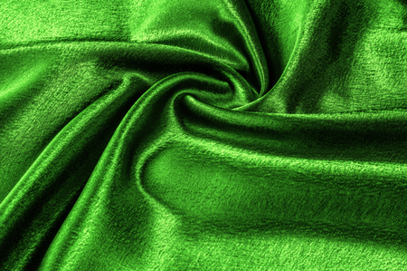 Photo for texture silk fabric is green metallic thread. metallic sheen. This metal gold and green abstract jacquard reminds us of the underwater paradise. Splashes of abstract design come out of the metal star - Royalty Free Image
