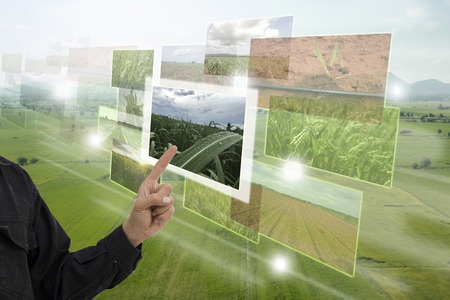 Photo pour Internet of things(agriculture concept),smart farming,industrial agriculture.Farmer point hand to use augmented reality technology to control ,monitor and mangement in the farm - image libre de droit