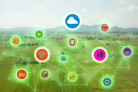 Foto de internet of things industrial agriculture,smart farming concepts,the various farm technology in the futuristic icom on the field background ict(information communication technology) - Imagen libre de derechos