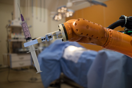 Photo for robot in medical concept, robot (artificial intelligence)hold the medical syringe in the operating room  for prepare to surgery the patient for faster recovery time, less cosmetic damage and low costs - Royalty Free Image
