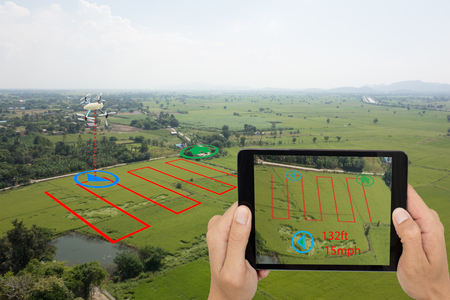 Foto de smart farming concept, drone use a technology in agriculture with artificial intelligence to measure the area, photographer, and fly follow the line and send the data back to farmer in cloud system - Imagen libre de derechos