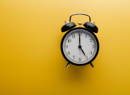 Photo for Alarm clock on yellow background top view. Concept of time. - Royalty Free Image
